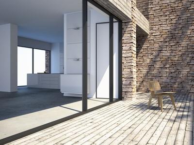 Photo d'une maison avec terrasse en bois